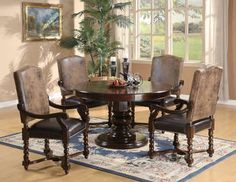 The Belleville Rich Mahogany Dining Set #11765 from Furniture From Home.  Round Table, $699.99.  Chairs, $319.99 ea.  5pc set, $1899.99.  Mahogany mmmmmm.  I like the legs on the chairs, the pedestal table, and the fact that the chairs aren't light colored on the seats.