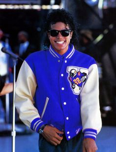 MJ BAD era attire: Black shades; Royal Blue and whtie leather jacket. Includes football imprint and design