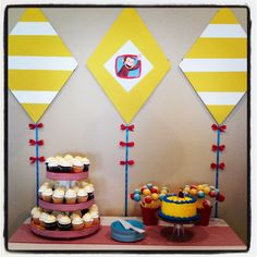 Curious George yellow and white kites above cake table!