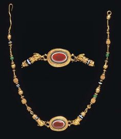 A GREEK GOLD, GLASS, AND STONE NECKLACE   HELLENISTIC PERIOD, CIRCA 2ND-1ST CENTURY B.C.