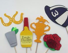 Kentucky Derby Photo Booth Props - Set of 6 includes Roses, Trophy, Jockey Hat, Mint Julep, Maker's Mark Bourbon, and Horseshoe Sunglasses. $40.00, via Etsy.