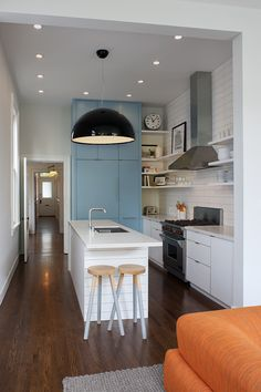 San Francisco Interior Design company Regan Baker Design - Castro Casual Kitchen, Kitchen Pendant Light, Counter Stools, Blue Cabinet Color, Midcentury Modern, Kitchen Shelving