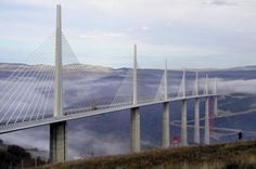 The Millau Viaduct rises above the cloud-covered River Tarn. The world's tallest bridge creates a direct route from Paris to the Mediterranean coast. Check out another picture of this amazing bridge on the next page.(Frank Renout/The Christian Science Monitor via Getty Images)