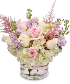 Beautiful Garden - This soft assortment of roses, hydrangea and stock arrives in a glass cylinder vase. A beautiful bouquet for any reason. #KittelbergerFlorist #RochesterFlowers
