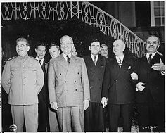 President Truman and Josef Stalin on the lawn outside of Soviet Union Prime Minister Stalin's residence during the Potsdam Conference in Potsdam, Germany. The group of men, L to R: Prime Minister Josef Stalin, Charles Bohlen, interpreter for President Truman, V. N. Pavlov, interpreter for Prime Minister Stalin, President Harry S. Truman, Andrei Gromyko, Soviet Ambassador to the United States, Charles Ross, U. S. Press Secretary, and Soviet foreign minister Vyacheslav Molotov., 07/18/1945