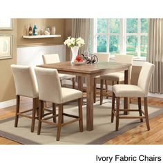 Enjoy rustic appeal with a modern twist. This compact dining set includes a 48-inch square counter height table featuring a natural wood design to match the chair legs. Six chairs are available in dark brown leatherette or ivory linen.