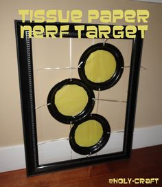 using tissue paper and plates to create Nerf target practice for a Nerf birthday party