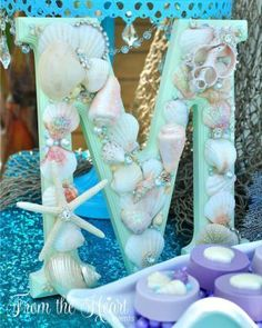 Custom Mermaid letters vintage sea shell sign for DIY under the sea mermaid birthday party. Who doesn't love mermaids?! This is genius! So perfect for kids birthday parties! Under the sea and the little mermaid as a party is awesome! So many DIY ideas that are easy and cheap. Which is even better since we done want to break our budgets throwing a mermaid party. I like the food, dessert, decorating, activity ideas! Love it saving it for later! #diypartykids