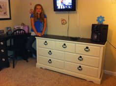 Cali letting Nana decorate her room.  The dresser is a yard sale find for $20.00.  Painted Annie Sloan Chalk Paint Old White.  The top of the dresser and drawer knobs are painted graphite.