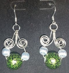 Flattering, Stylish hand-crafted wire formed earrings - emerald green and silver - Artisan - Silver Plated by FireryangelCreations on Etsy