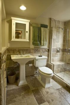 Traditional Bathroom Remodel traditional bathroom with light tan tile shower wall covering