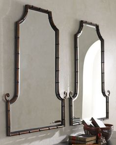 Flat-topped, arched mirror sold individually. Mirror is beveled. Bamboo-inspired frame is handcrafted of iron rods. Hand-painted antiqued gold finish with matte black inner lip and black iron band acc