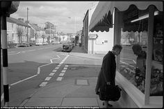 A woman examines the meat on display in the window of a local butcher shop Black N White Images, Black And White, Local Butcher Shop, Country Picnic, North Devon, Travel News, Dog Walking, Seaside, Britain