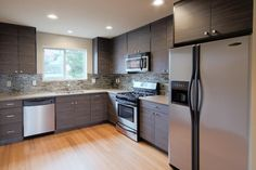 Contemporary kitchen remodel with sleek cabinets in shades of gray.
