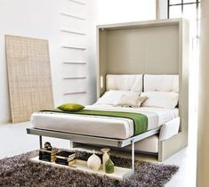 The bed drops down over the sofa.from Resource Furniture Murphy Bed Couch, Murphy Bed Plans, Sofa Bed, Sofa Cushions, Bed Pillows, Resource Furniture, Furniture Ideas, Furniture Design, Space Saving Beds