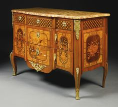 A Louis XV/XVI transitional ormolu-mounted, mother-of-pearl and ivory-inlaid tulipwood, amaranth, fruitwood and marquetry commode circa 1785...