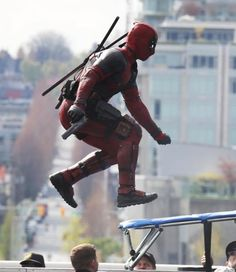 New Photos Show Deadpool in Action and Ryan Reynolds's Scarred Face