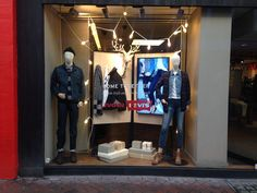 """Levi's  Window friendly, authentic and natural levi's look for a Christmas """"come together"""". #chirstmas #denim #fairy #light #retail #highstreet #london #2014"""