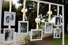 Parents' and grandparents' wedding pictures above the guest book table.