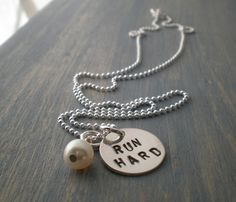cute! shop also has charms you can get with different race distances on them. www.greennutrilabs.com
