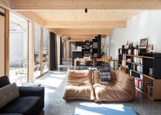 GAFPA inserts wooden house into the shell of an old Belgian industrial building