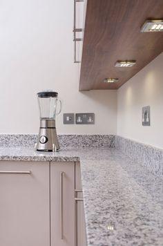 American walnut veneer surround containing LED surface lighting, Work surfaces in Sardo grey granite. Gray Kitchen Countertops, Handmade Kitchens, American Walnut, Boconcept, Corian, Walnut Veneer, Bespoke Furniture, Work Surface, Cream Kitchens
