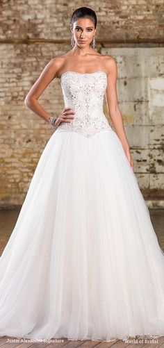 A train meant for royalty. This strapless tulle ball gown has opulent beadwork on the bodice, a basque waistline, and a monarch length train.