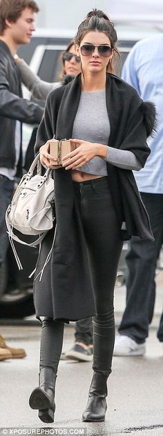 Winter chic: She was later seen leaving the photo shoot, dressed more warmly in a black fu...