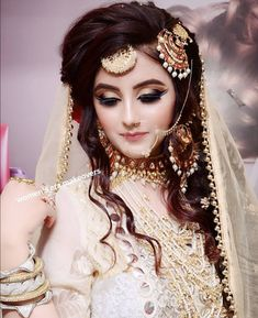Portrait of a beautiful female fashion model in ethnic asian indian bridal costume with heavy jewellery and makeup , Pakistani Bridal Makeup, Pakistani Wedding Outfits, Bridal Dupatta, Pakistani Couture, Bridal Outfits, Pakistani Dresses, Indian Outfits, The Bride, Bride Look