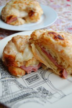 Croque Monsieurs.....is a grilled ham and cheese sandwich. It originated in French cafés and bars as a quick snack. Typically, Emmental or Gruyère cheese is used. The sandwich's first recorded appearance on a Parisian café menu was in 1910.