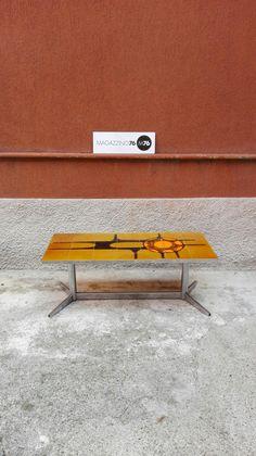 Tavolino da caffe anni 70 con piano smaltato con decoro tipico dell epoca, zampa in acciaio cromato 1970 Ottime condizioni Misure 90x40x40h #magazzino76 #viapadova #Milano #nolo #viapadova76 #M76 #modernariato #vintage #industrialdesign #industrial #industriale #furnituredesign #furniture #mobili #anni70 #smaltato #modernfurniture #antik #antiquariato  #divani #tavolino #coffeetable #spaceage #cromature