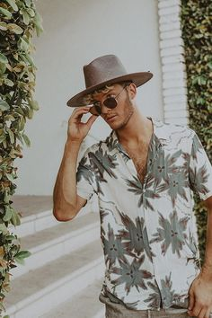 09d9ba2dd8d43 Class up that tropical floral print with this super wide brim.  Tyfrench  ties in