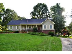 Great home with finshed basement located on amazing 2 acre lot with barn and outbuildings. If you are looking for a great piece of property you must see this home. Home features a finished basment with great room, 3 bedrooms, 3 baths, brick fireplace, front porch, garage with workshop and much more.