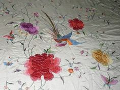 Beautiful white silk shawl embroidered with flowers, birds and butterflies.