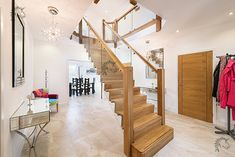 Z-Vision oak and glass central feature staircase Oak Handrail, Stair Banister, House Staircase, Home Stairs Design, Modern House Design, Staircase Manufacturers, House Extension Plans, Glass Stairs, Floating Staircase