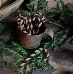 Prim grunged caneswith rusty jingle bells greens cinnamon primitive brown candy canes for your christmas tree packaged for gift giving publicscrutiny Choice Image
