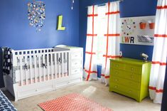 Bold blue nursery with lime green and orange accents