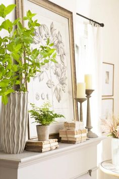 Serene and green     This mantel highlights serene green and natural tones. The framed plant sketch ties together both the natural and neutral aspects of the mantel. Rest art on the mantle to avoid new wall holes for seasonal decorating. Potted plants add height and a pop of color.
