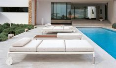 """'SPRINGTIME' BY JEAN-MARIE MASSAUD, DEVELOPS THE THEME OF THE """"À CABANE"""" SEAT WITH DEEP SEATING SOFAS THAT CAN BE SHADED BY A LIGHT TEXTILE OR RATTAN COVER TO CREATE PRIVACY. THE SOFAS, WITH THEIR RIGOROUS LINEAR FRAMES, ARE DESIGNED IN TWO SEATING DEPTHS, A CHAISE LONGUE WITH EITHER A SINGLE SEAT ON CASTORS AND ADJUSTABLE HEADREST OR A DOUBLE SEAT PLACED EITHER IN PARALLEL OR FACE TO FACE. IN ADDITION THERE IS THE OPTION OF RECTANGULAR AND SQUARE TABLES THAT CAN BE CONVERTED INTO VASE…"""