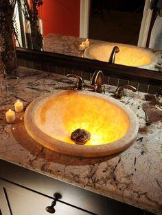 Metallic Influences - Budget-Friendly, Masculine Bathroom on HGTV--I like the lit sink