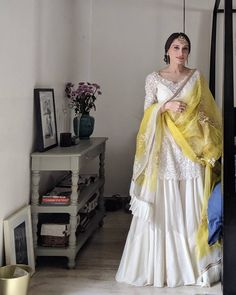 Bride in a short white kurta and sharara pants on her haldi function - indian fashion Sharara Designs, Lehenga Designs, Pakistani Dresses Casual, Pakistani Wedding Outfits, Pakistani Dress Design, Bridal Outfits, Pakistani Mehndi Dress, Pakistani Clothing, Pakistani Fashion Casual