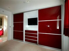 23 Admirable Wardrobe Designs To Inspire You : Modern Red Painted Wall Units Wardrobe Design with TV and Drawer in the Center