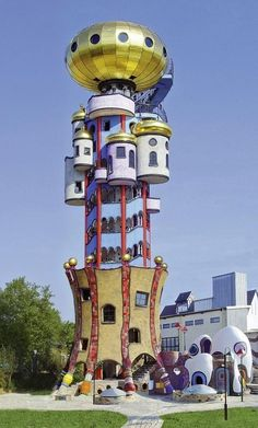 Kuchlbauer Tower by Austrian architect Friedensreich Hundertwasser (1928-1986): Built on the grounds of a brewery in Bavaria, Germany. Curves instead of corners edges, green roofs, custom windows, onion domes colorful, playful facades are hallmarks of Hundertwasser's style.