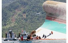 Sunken passenger ferry. US assisted search and rescue operation in the Philippines. A storm overturned a seven-storey ferry