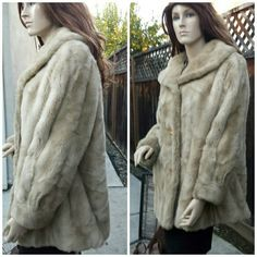 """Vintage Faux Fur Dinner Coat-Dubrowsky & Joseph Tissavel France exclusively styled for Dubrowski & Joseph, Made in the USA. It's in beautiful vintage condition. Luxurious soft light gold lining in perfect condition. 4 buttons down the front. Tan and cream colors blended like fur. I've inspected closely and see no flaws or stains. Truly gorgeous! Shoulder to hem 29"""", armpit to armpit 20"""", sleeves 23"""". Vintage Jackets & Coats"""