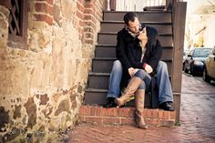 engaged couple sitting on stairs, cuddling. Urban City Pre-wedding Engagement Photographer Annapolis MD