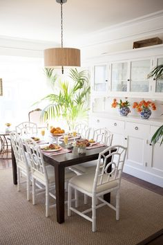 Faux Bamboo Chairs + Bright White Dining Room (Home of Mary Graf of Le Cart SF via Glitter Guide)