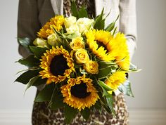 Jane-Packer-Delivered-Summer-2012-Carnaby-Street Sunflowers amongst cream and pale yellow roses, plus foilage.