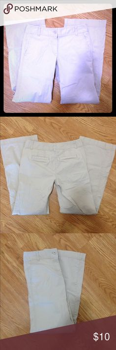 LOFT Signature chino pants size 2 Ann Taylor LOFT beige signature chino pants size 2. Features 2 front pockets and 2 back pockets. Inseam is 31 inches. Has a few tiny spots at the ends of pant cuffs, but is otherwise in excellent condition. LOFT Pants Trousers