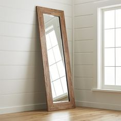 A rustic modern addition to any room, this floor mirror has a bold frame composed of scraps of reclaimed seguro wood. Rich in the natural color and texture of the particular wood pieces used, each mirror is unique.